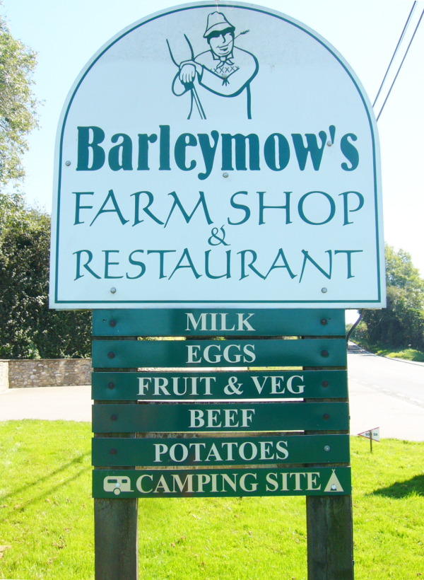 Sign on road by entrance to Barleymows Farm Shop, Cafe and Florist