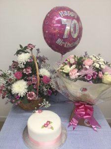 Birthday celebration gifts, flowers, helium balloon